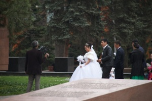 Wedding couple at the War Memorial in Panfilov Park, Almaty