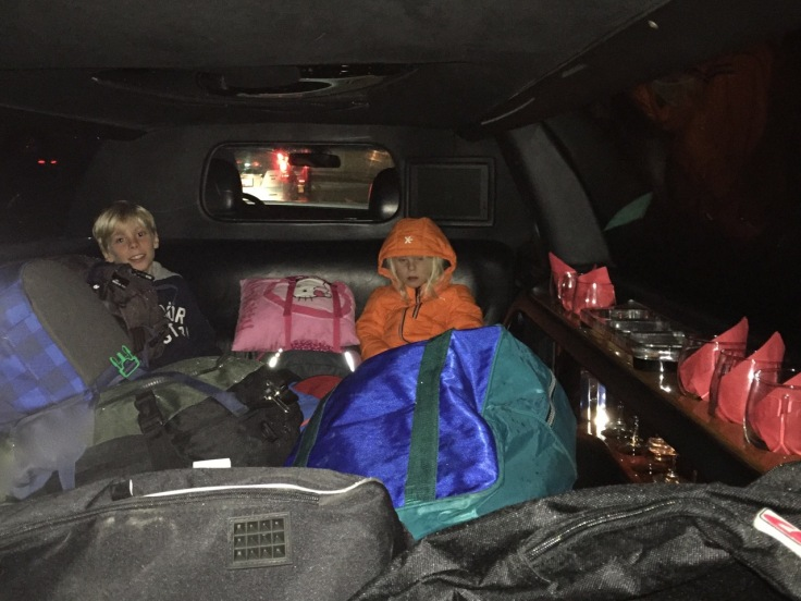 Creative use of a stretch limo: baggage and kids - couldn't enjoy the bar on the right side of the picture